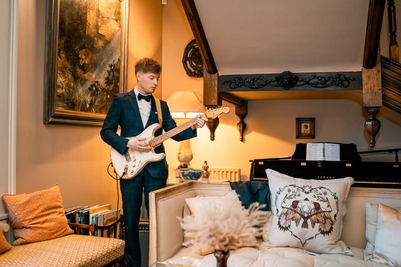 Man playing electric guitar at wedding
