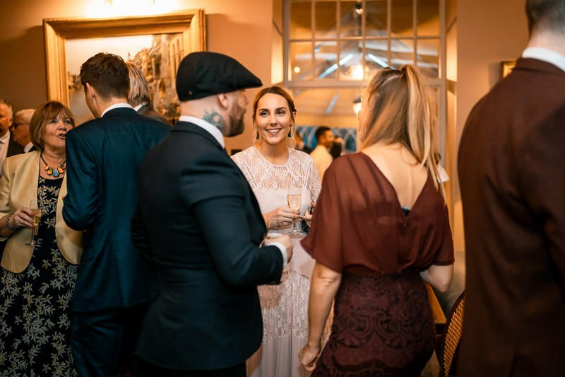 Wedding guests talking during welcome drinks