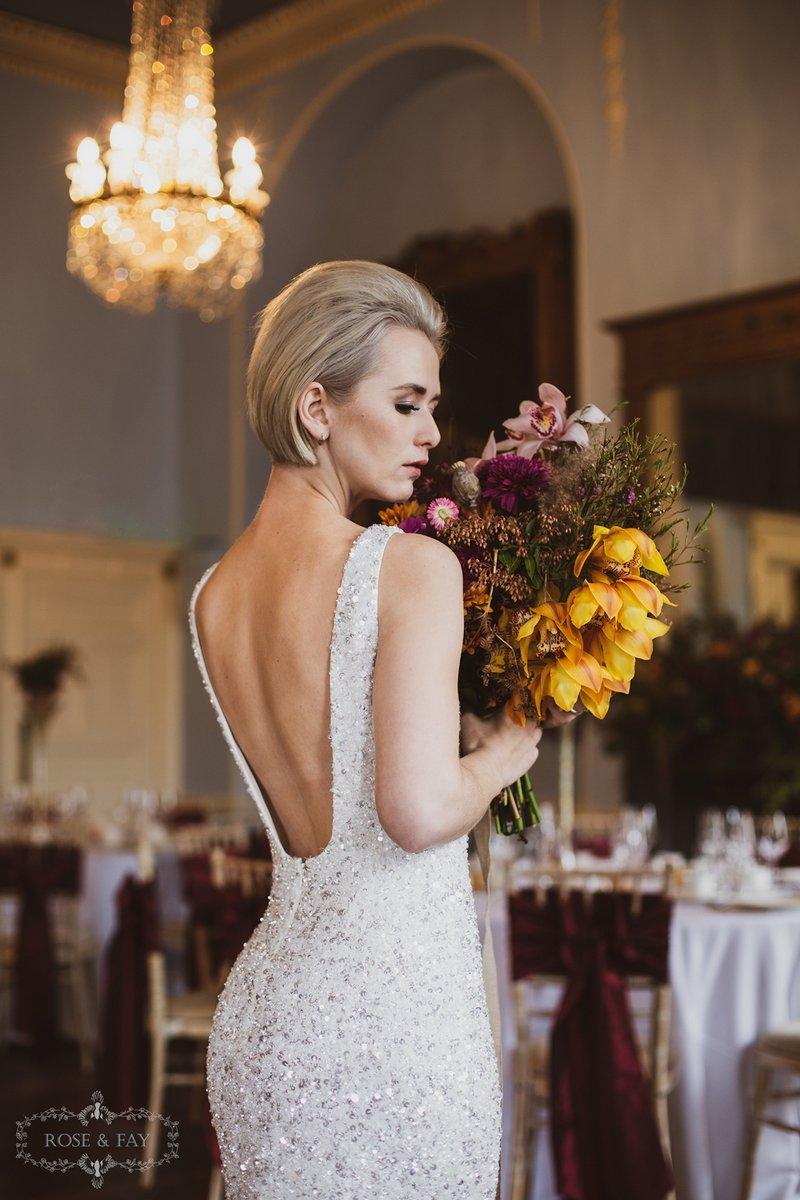 Bride holding autumnal bouquet