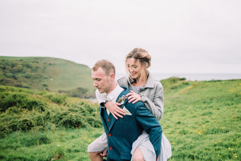 Groom giving bride piggyback