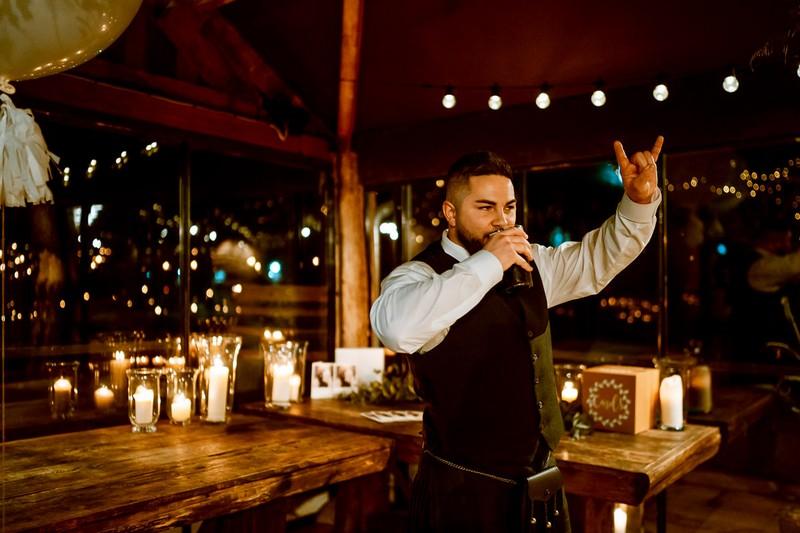 Groomsman drinking at wedding
