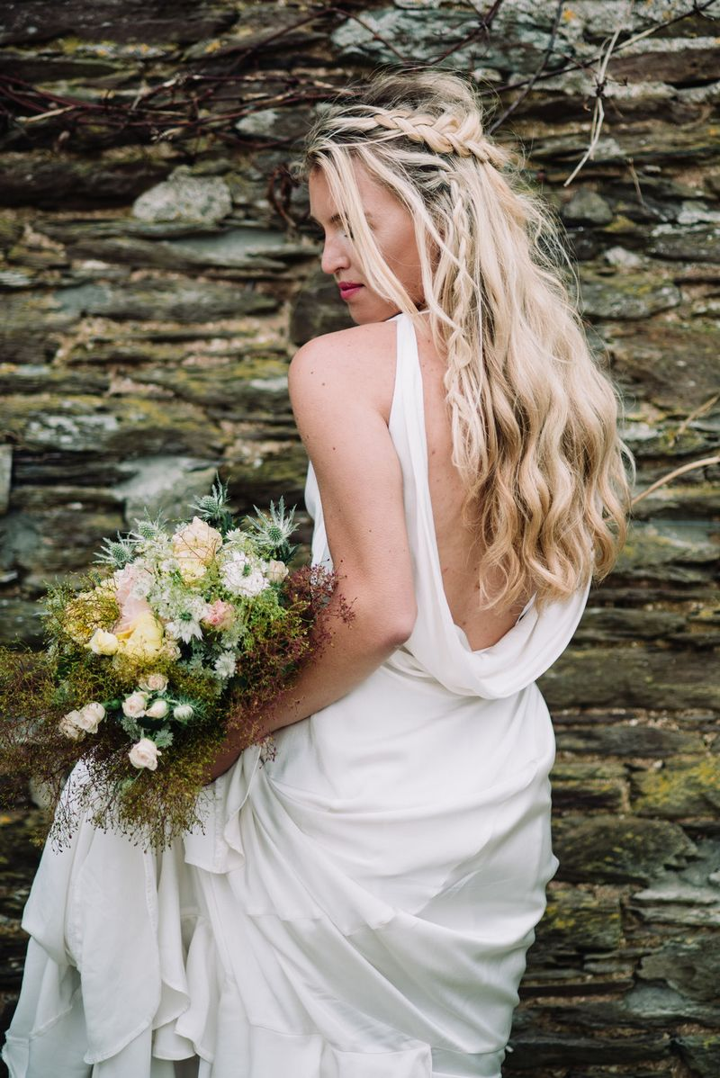 Bride showing draped back of her wedding dress