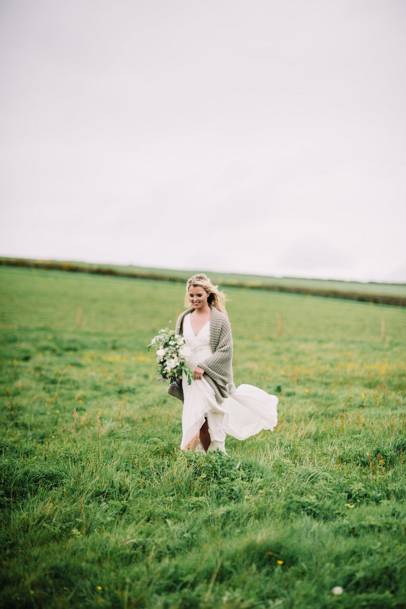 Bride walking across field