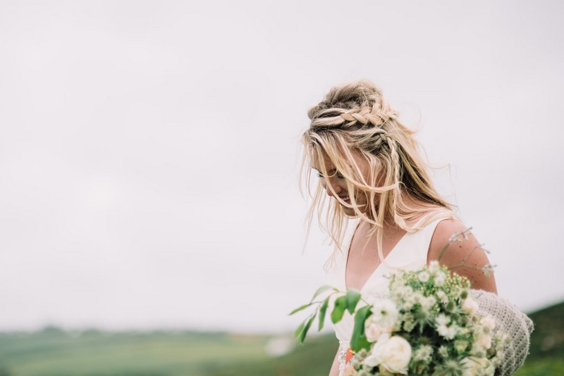 Bride with braid in messy hair