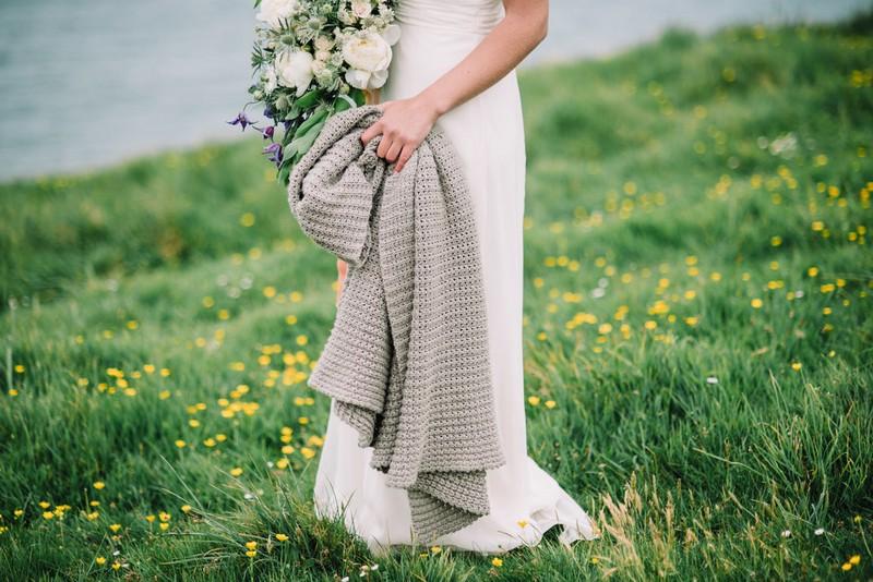 Bride holding grey shawl