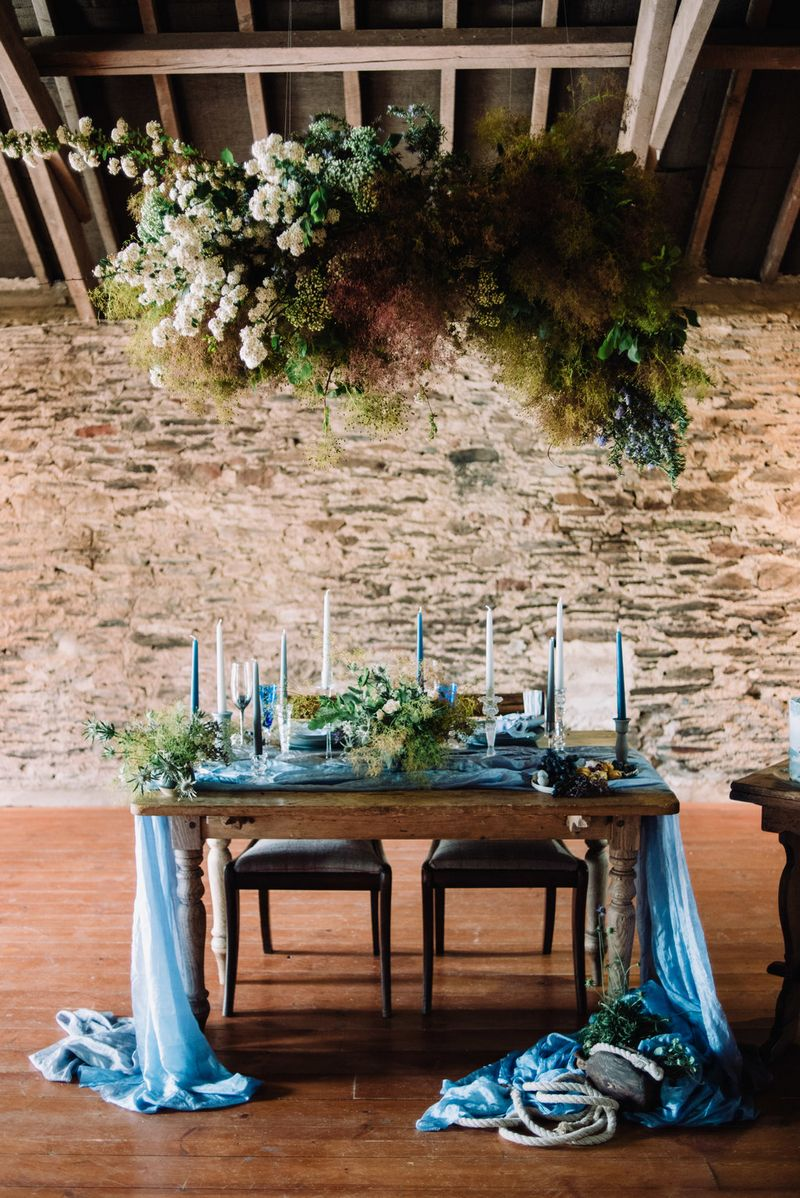 Small wedding table under hanging installation
