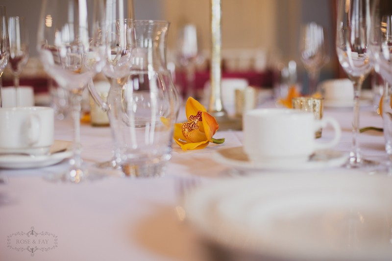 Orange/yellow flower on wedding table