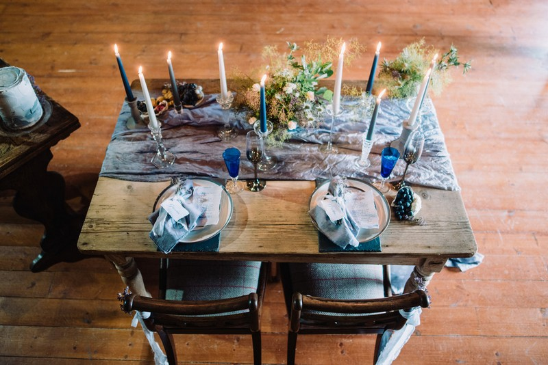 Small wedding table with blue linen and grey styling