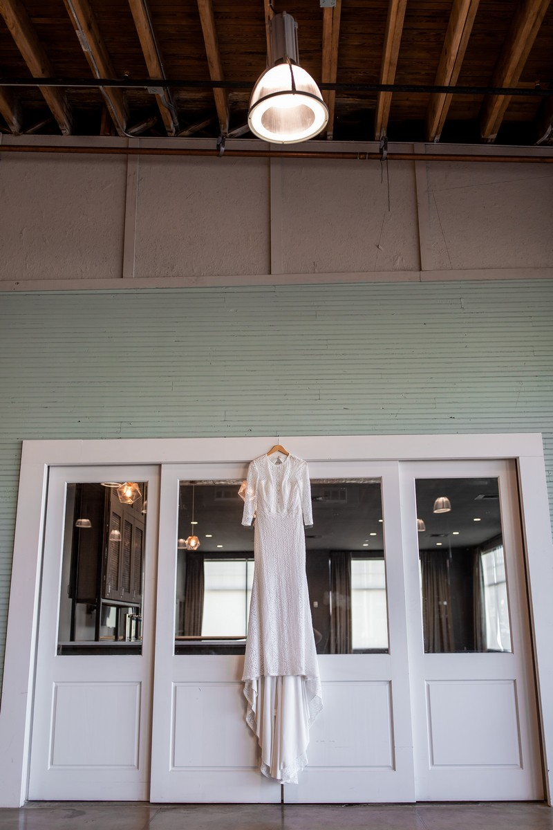 Wedding dress hanging over doors in Events at Haven