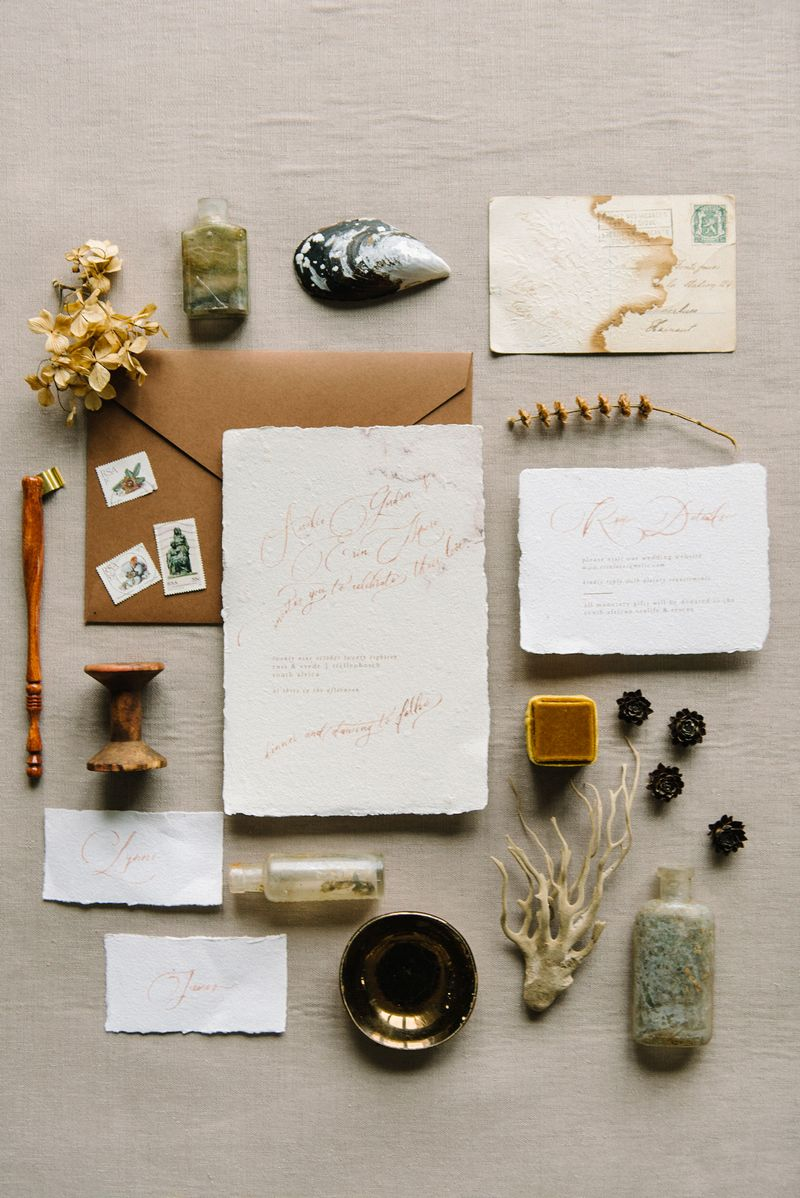 Rustic style wedding stationery with beach related items