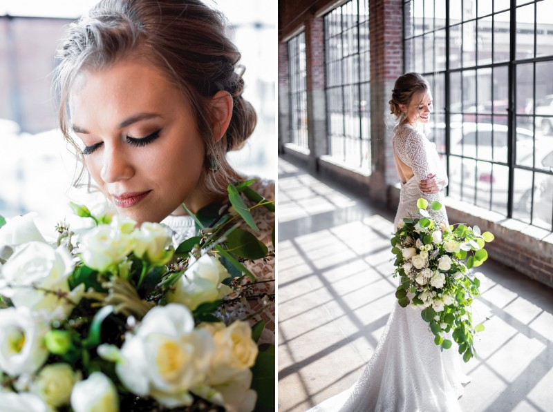 Bride with large bouquet of foliage and white roses