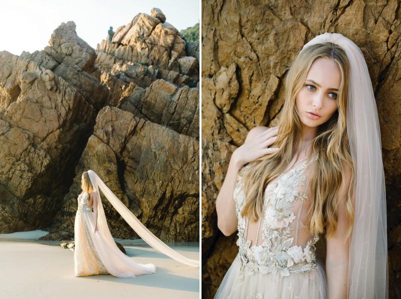 Bride with long veil walking across beach