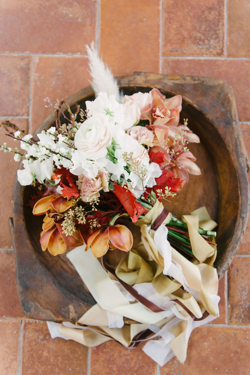 Autumnal wedding bouquet in wooden bowl