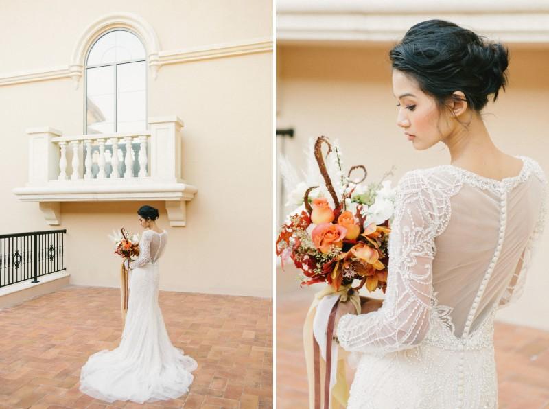 Elegant bride holding autumnal bouquet