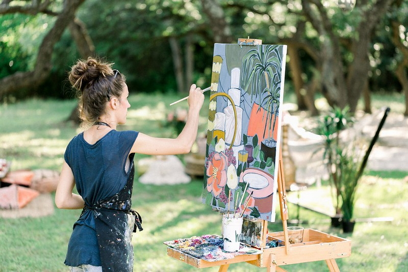 Artist painting bridal shower styling