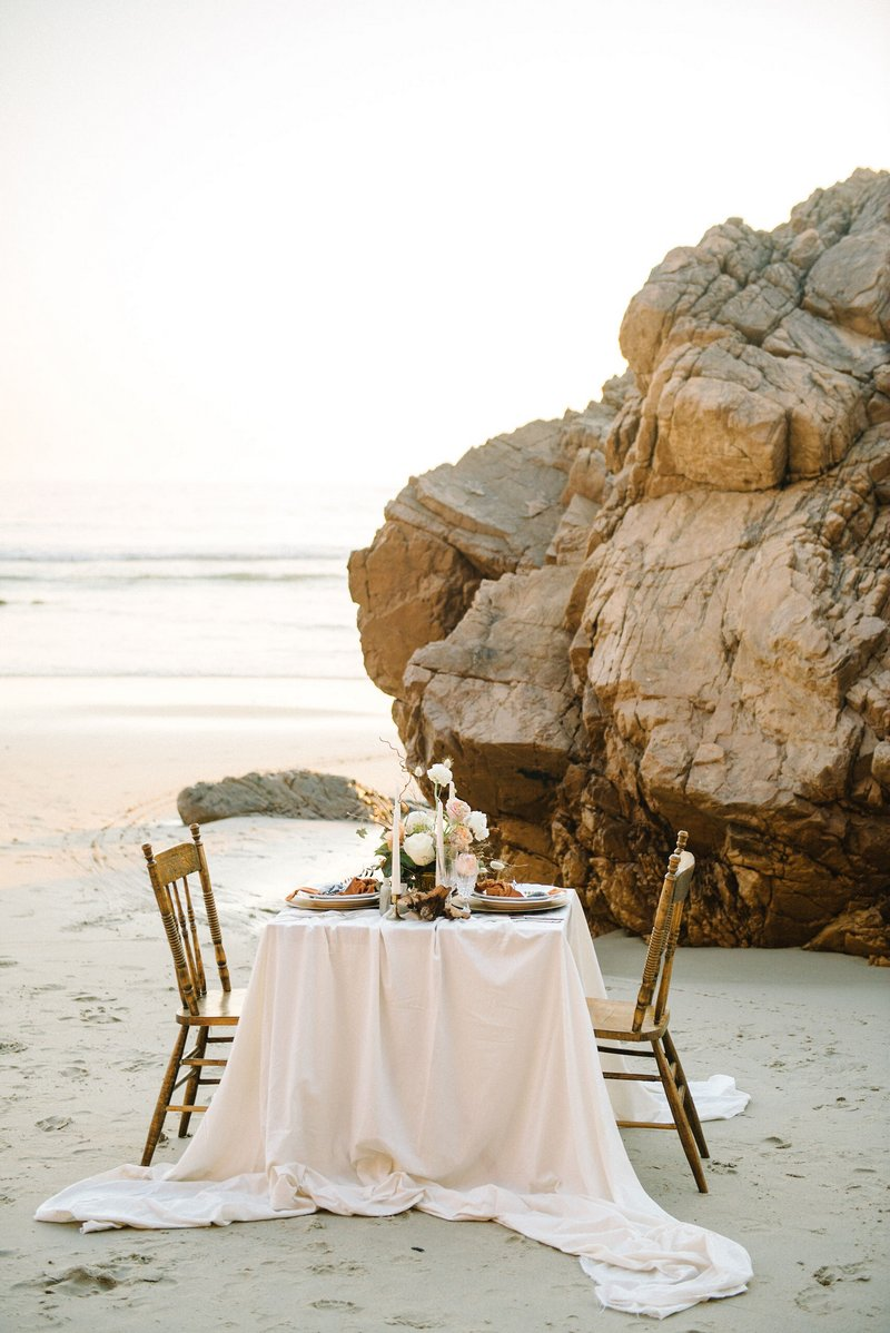 Small wedding table on beach by the sea