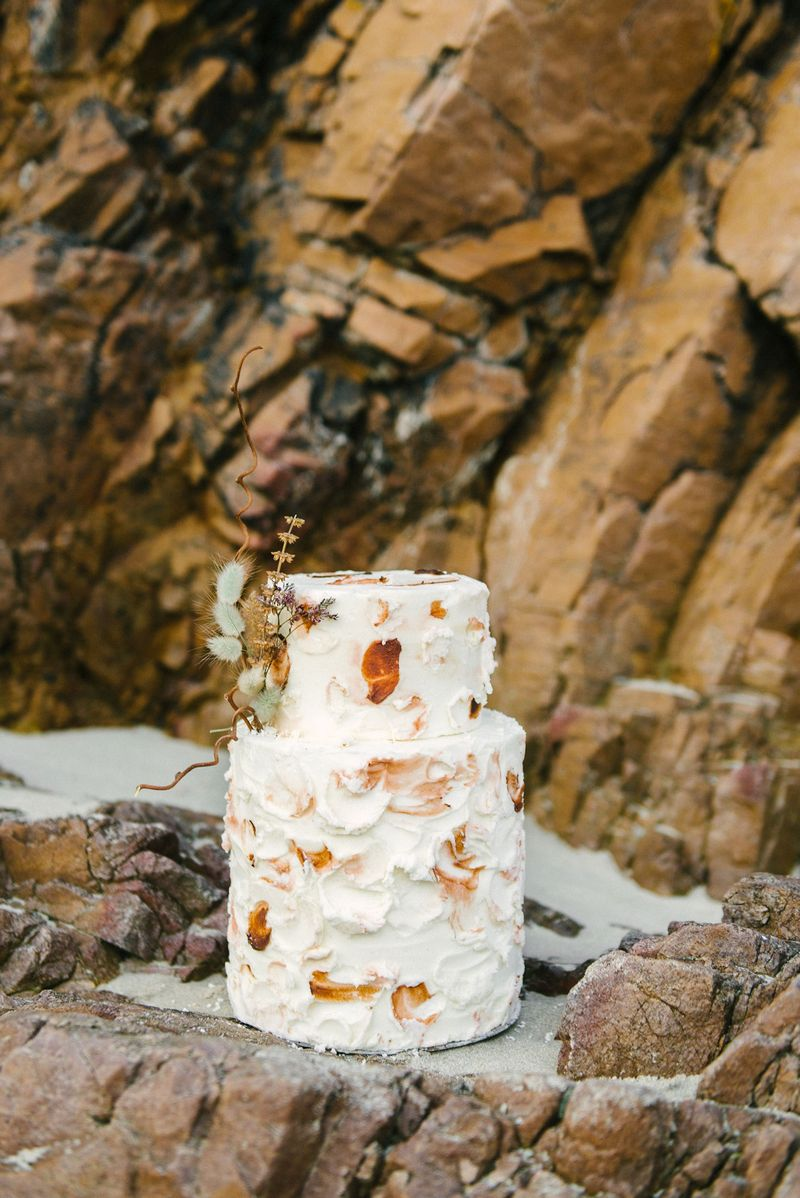Wedding cake with rust coloured detail