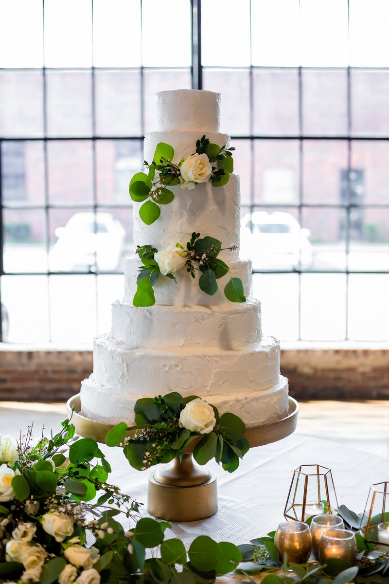 Wedding cake decorated with foliage