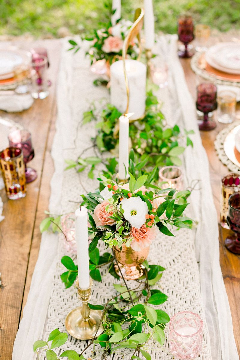 Foliage on top of macramé table runner