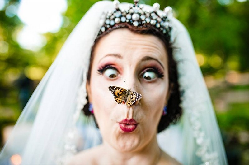 Bride with butterfly on her nose - Picture by Creatrix Photography