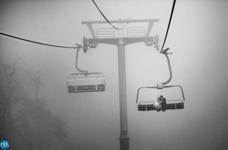 Bride and groom on ski lift - Picture by Nix Weddings