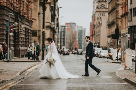 Bride and groom crossing the road in city - Picture by Sarah Maria Photography
