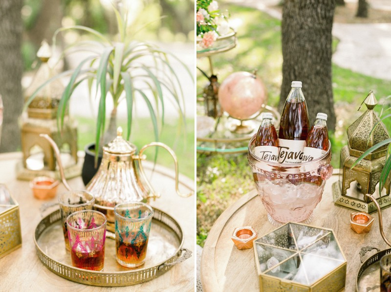 Moroccan teapot, tea glasses and bottles of iced tea