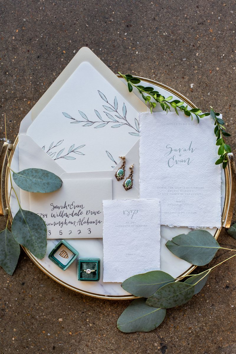Wedding stationery with foliage detail on gold rimmed tray