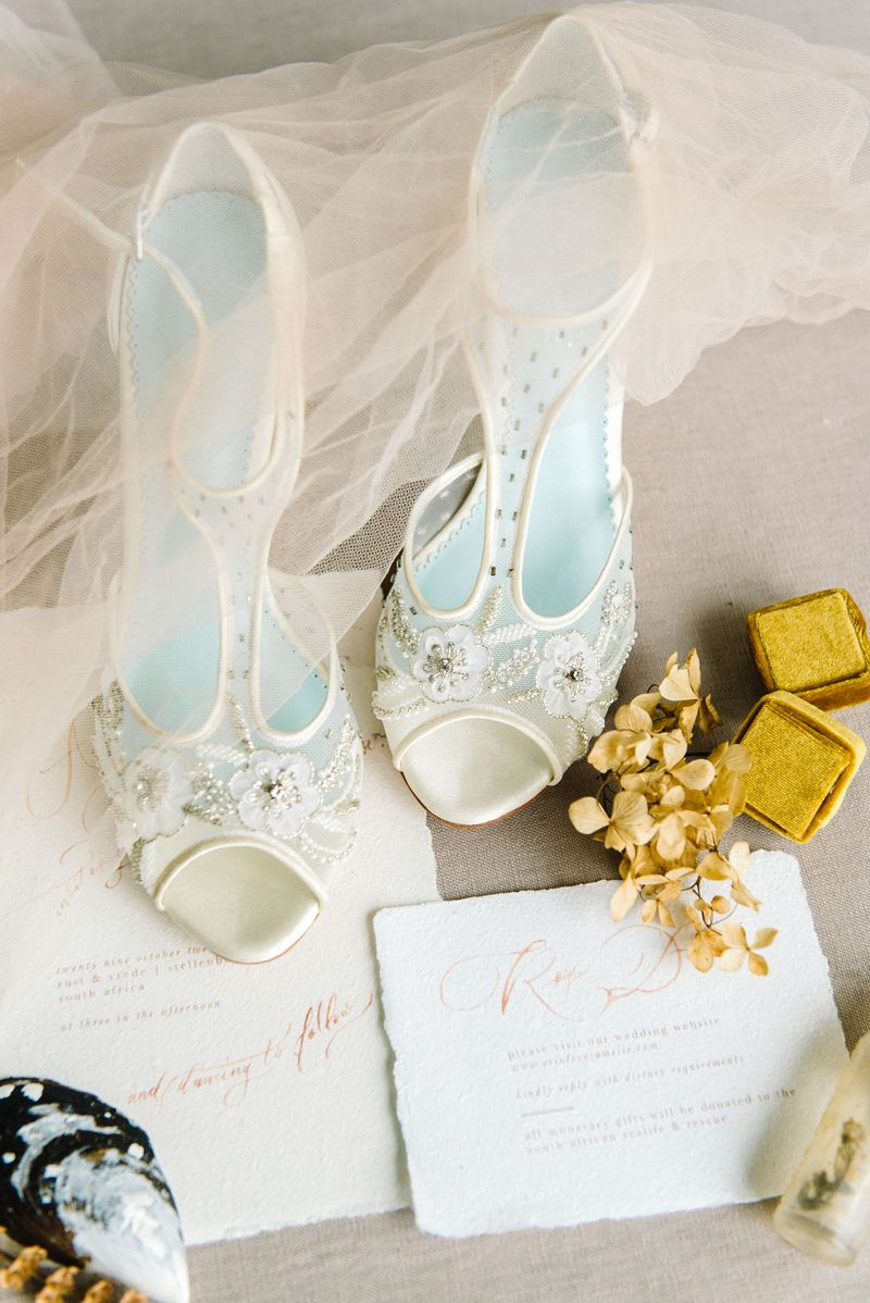 Bridal shoes with rustic wedding stationery