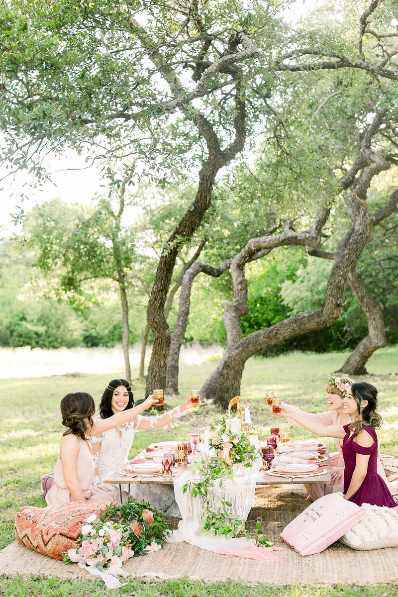 Girls sitting at low-level table for outdoor bridal shower