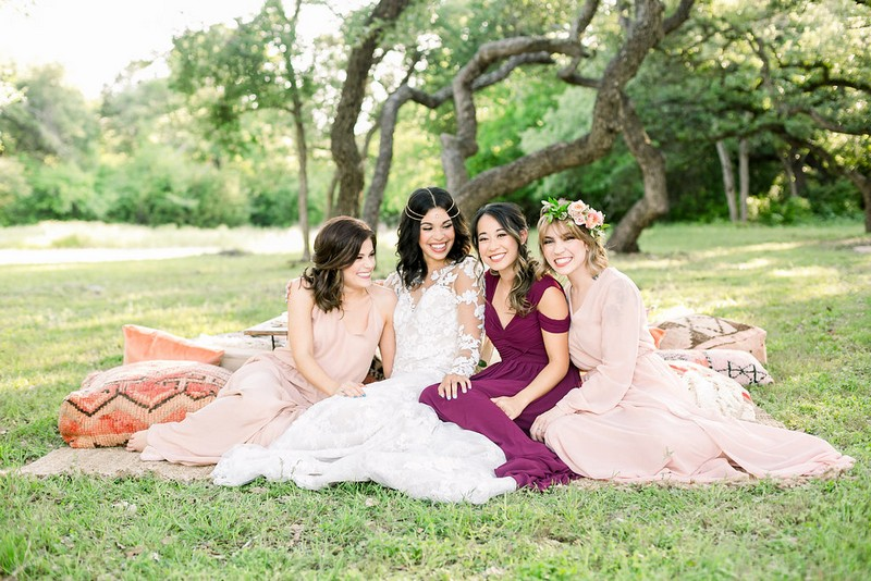 Bride-to-be and friends sitting on grass