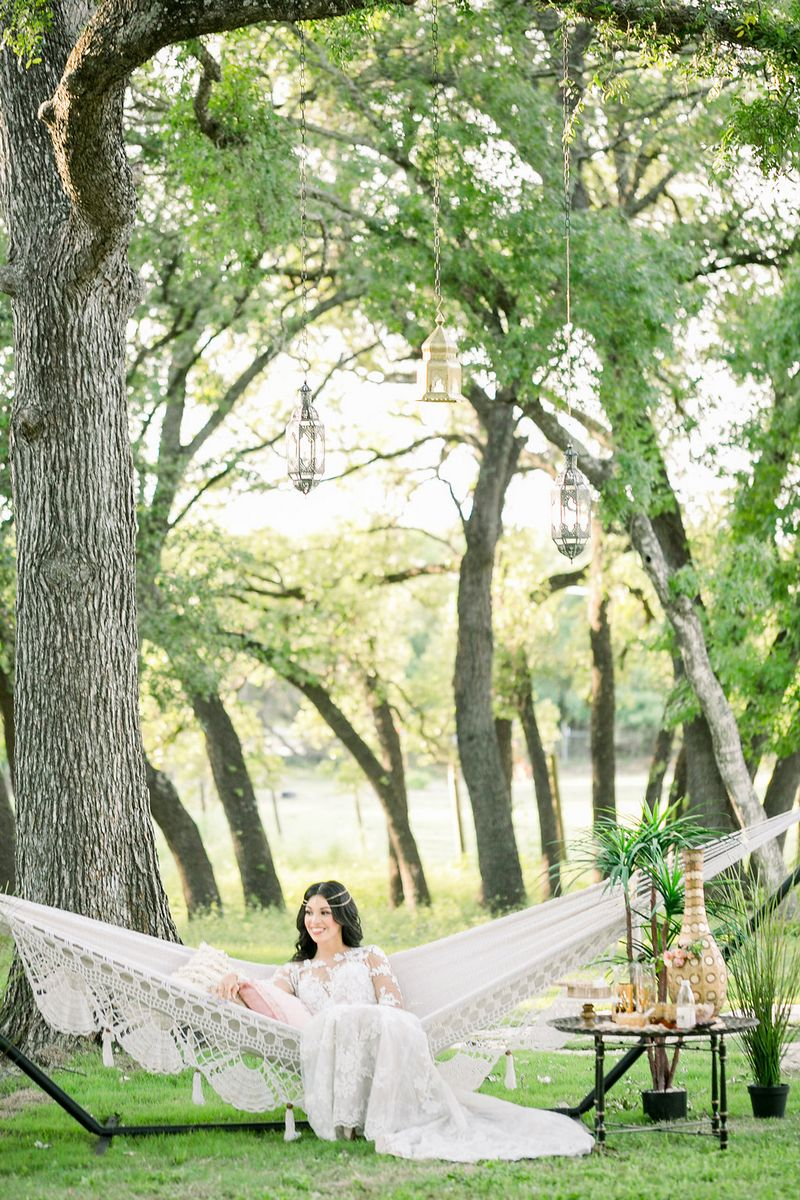 Bride-to-be sitting in hammock