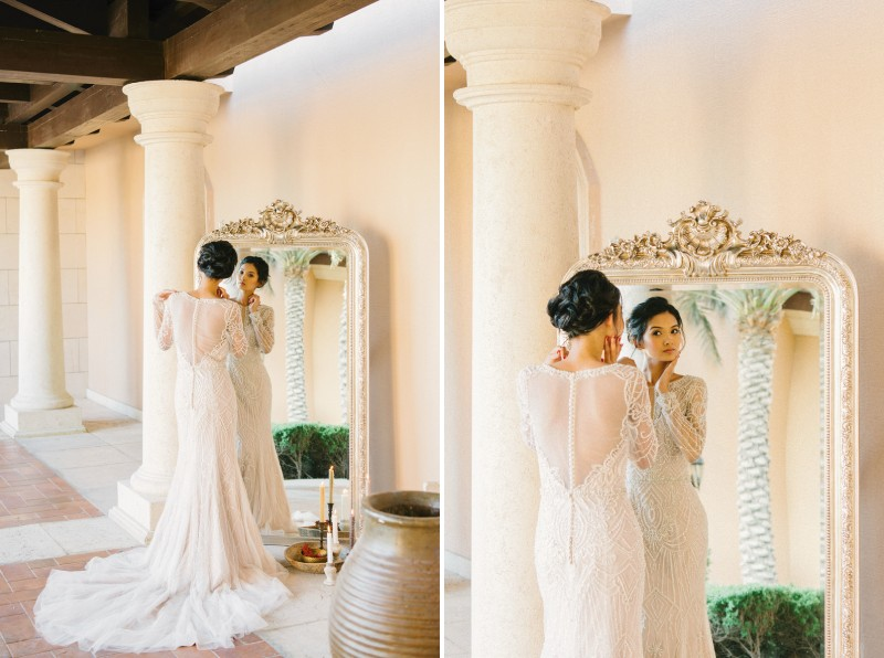 Bride looking in floor length mirror