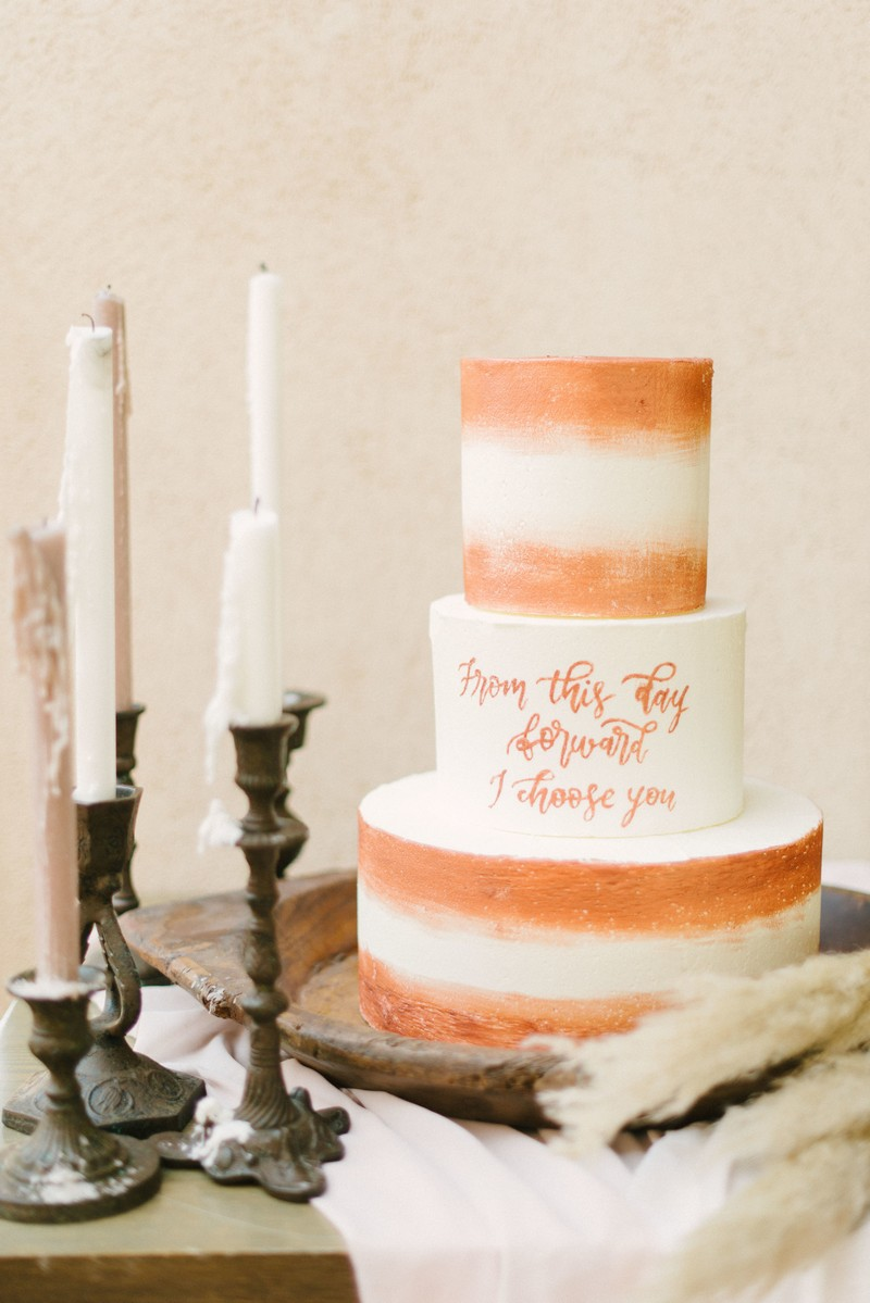Wedding cake with terracotta coloured detail and lettering