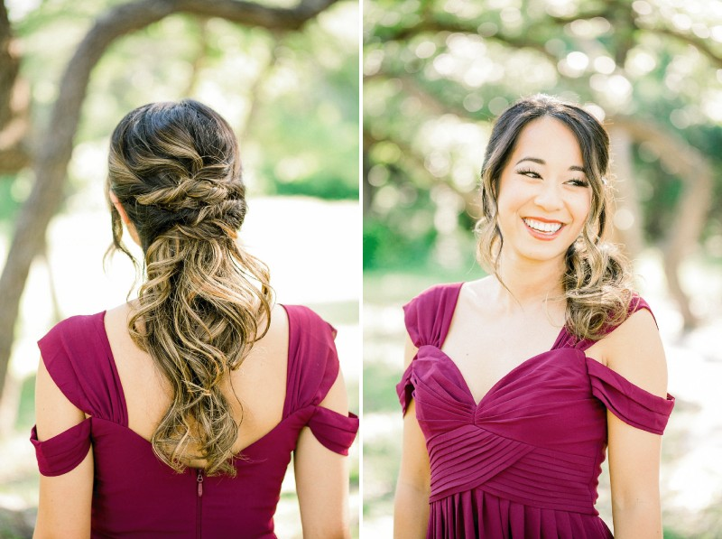 Bridesmaid with messy braid hairstyle wearing maroon dress