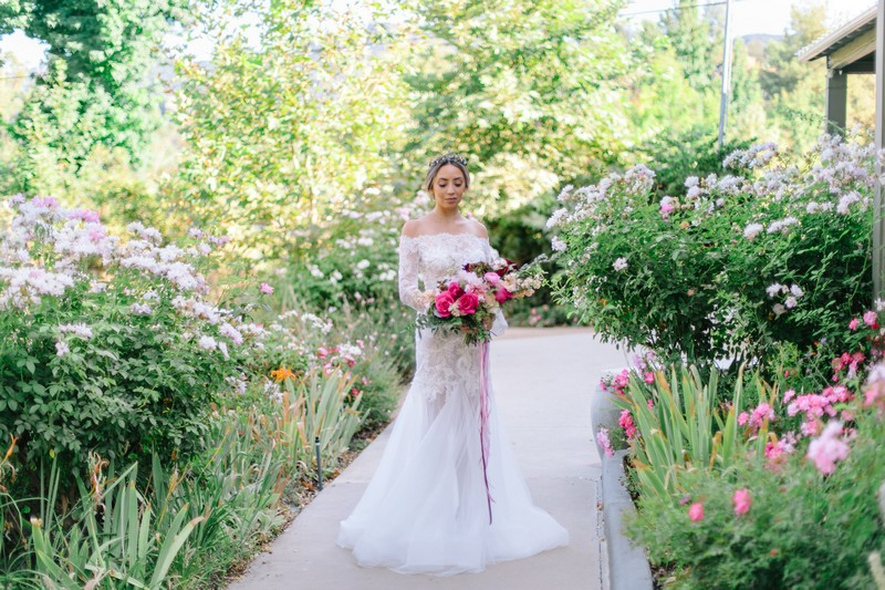 Bride holding burgundy and pink wedding bouquet