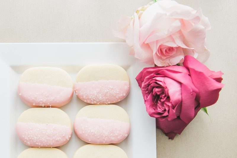 Pink iced shortbread biscuits with roses