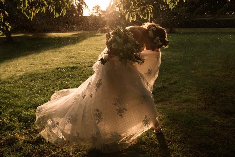 Bride ducking under tree