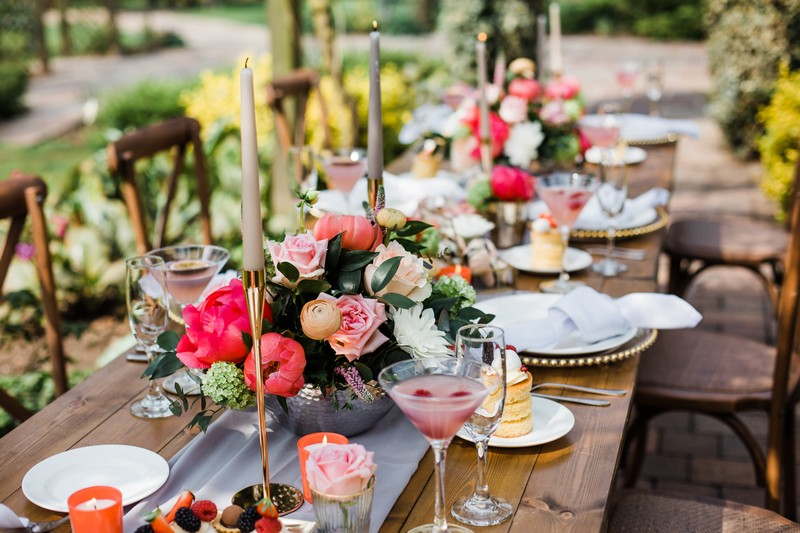 Wedding table styling with flowers and gold candlesticks