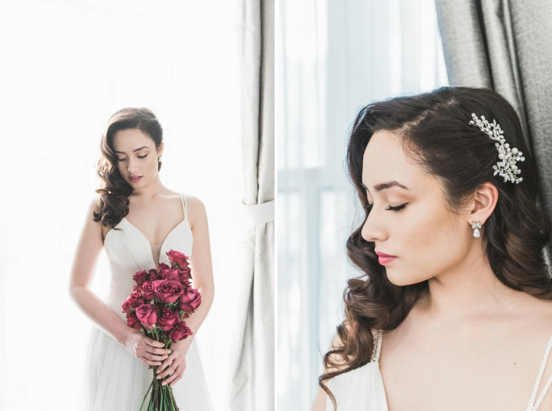 Bride with hair accessory holding pink bouquet