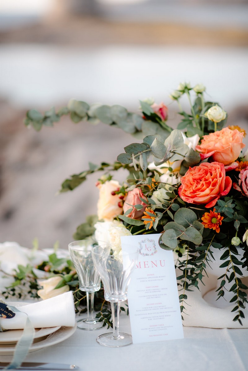 Flowers and menu on small wedding table
