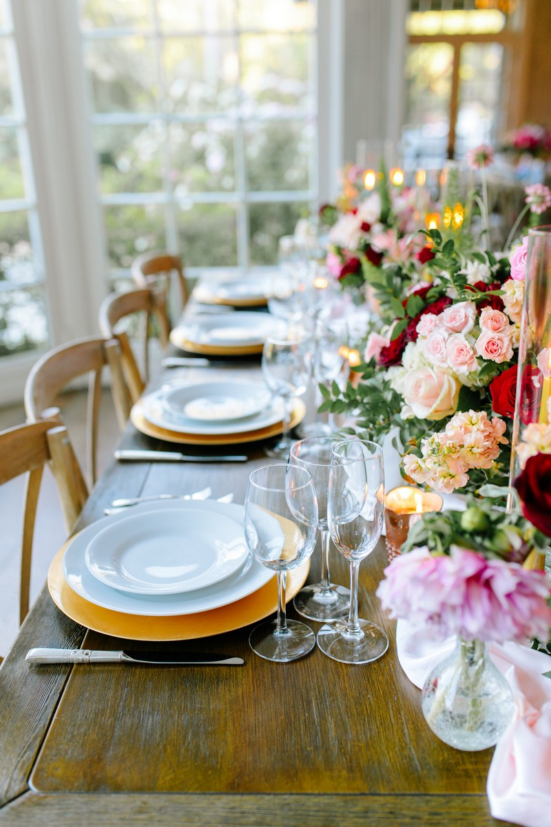 Rows of wedding plates on yellow chargers