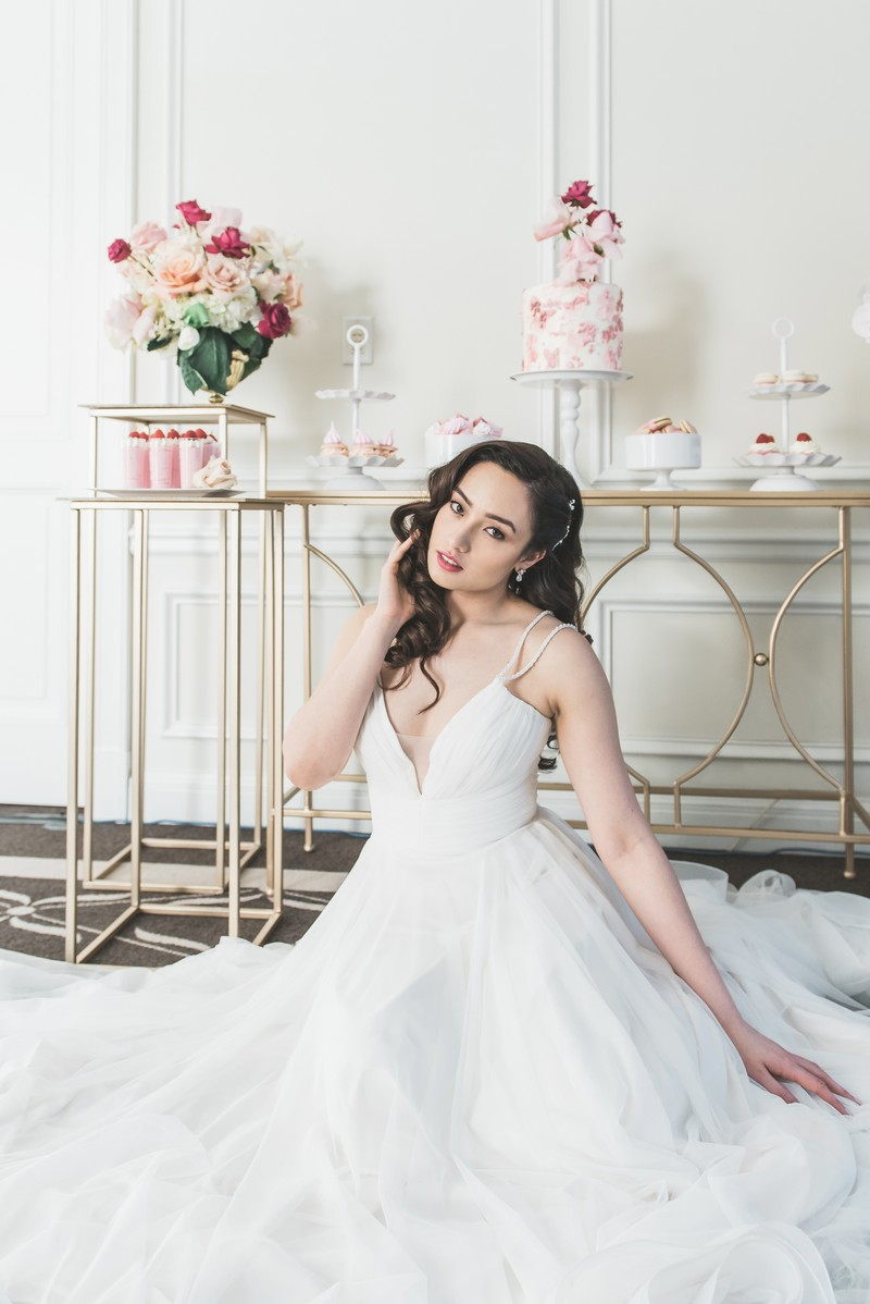 Bride sitting in front of dessert table