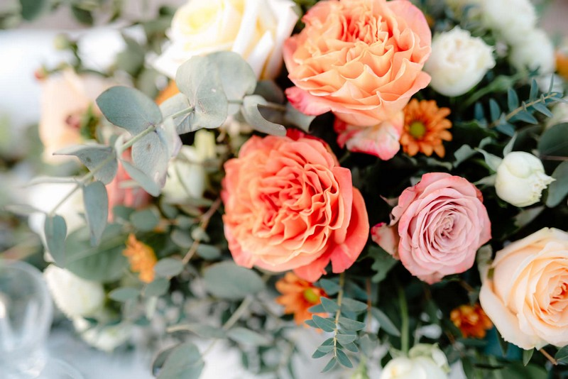 Orange and blush wedding table flowers
