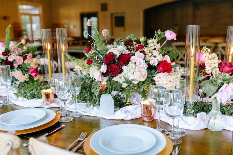 Burgundy and pink wedding table flowers