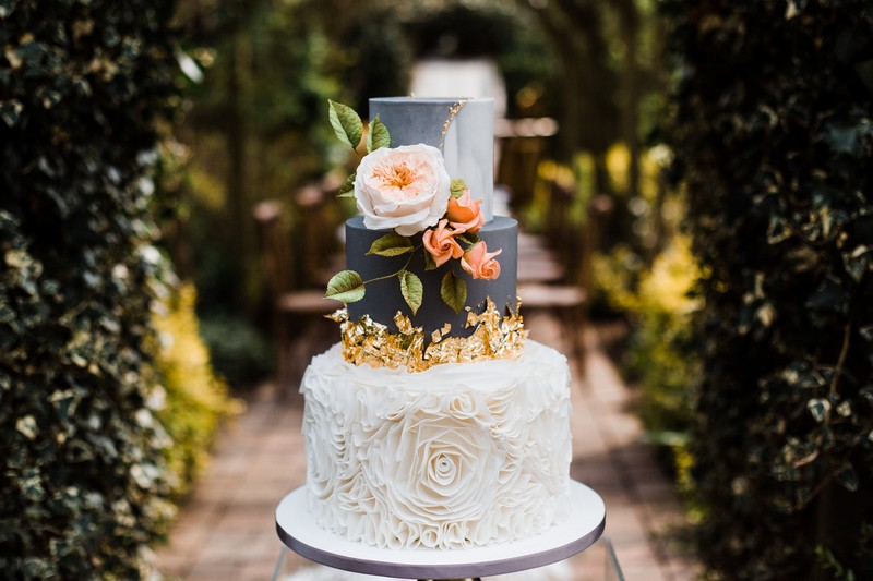 Grey and white marble wedding cake with gold leaf
