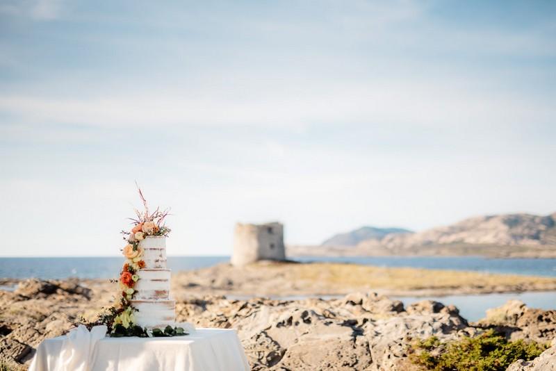 Naked wedding cake on La Pelosa beach in front of Torre della Pelosa