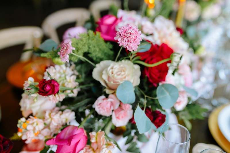 Wedding floral arrangement with burgundy, pink and white flowers