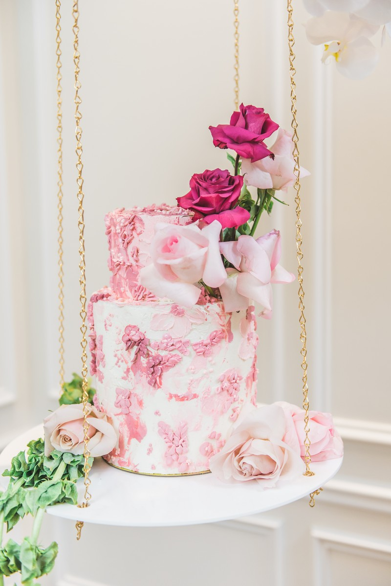 Hanging pink wedding cake suspended by chains