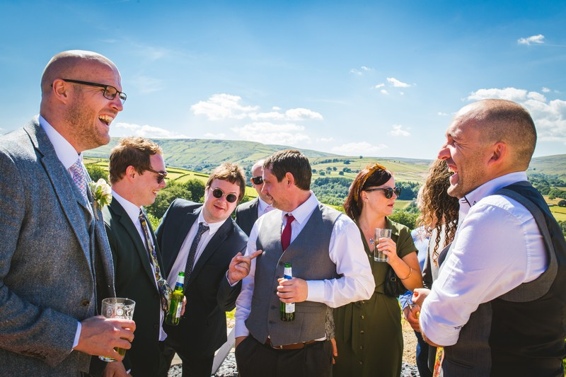 Groom with friends at wedding